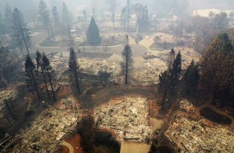 PARADISE, CA - NOVEMBER 15: An aerial view of a neighborhood destroyed by the Camp Fire on November 15, 2018 in Paradise, California. Fueled by high winds and low humidity the Camp Fire ripped through the town of Paradise charring over 140,000 acres, killing at least 56 people and destroying over 8,500 homes and businesses. The fire is currently at 40 percent containment.   Justin Sullivan/Getty Images/AFP
