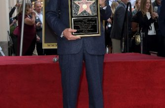 HOLLYWOOD, CALIFORNIA - NOVEMBER 06: Michael Douglas poses with his star at the Hollywood Walk of Fame Ceremony Honoring Michael Douglas on Hollywood Boulevard on November 06, 2018 in Hollywood, California.   Charley Gallay/Getty Images for Netflix/AFP