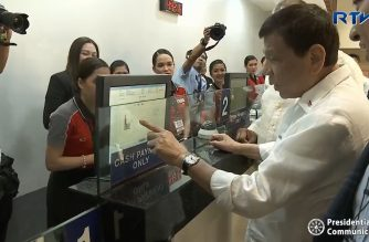 President Rodrigo Duterte tries out for himself the centralized ticketing system at the Parañaque Integrated Terminal Exchange (PITX) during the inauguration of the first of its kind landport in Paranaque City on Monday, Nov. 5, 2018.  (Photo grabbed from RTVM video)