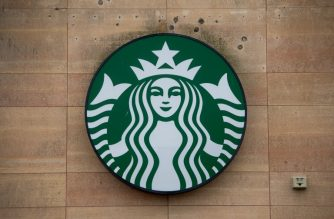 """The sign for a Starbucks Coffee shop is seen in Washington, DC, April 17, 2018, following the company's announcement that they will close more than 8,000 US stores on May 29 to conduct """"racial-bias education"""" following the arrest of two black men in one of its cafes. (Photo by SAUL LOEB / AFP)"""