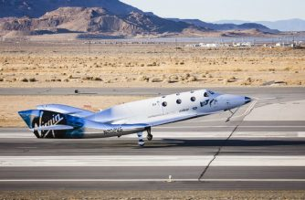 """This December 3, 2016 handout photograph obtained courtesy of Virgin Galactic shows the Virgin Spaceship (VSS) Unity as it touches down after flying freely for the first time after being released from Virgin Mothership Eve (VMS Eve) in the Mojave Desert, California. (Photo by HO / Virgin Galactic / AFP) / With AFP Story by Ivan COURONNE: First space tourist flights could come in 2019   == RESTRICTED TO EDITORIAL USE  / MANDATORY CREDIT:  """"AFP PHOTO /  VIRGIN GALACTIC"""" / NO MARKETING / NO ADVERTISING CAMPAIGNS /  DISTRIBUTED AS A SERVICE TO CLIENTS  =="""