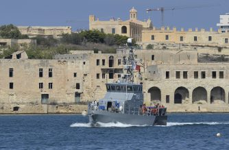 A group of 58 migrants picked up from small boats by the migrant ship Aquarius and transferred to an Armed Forces of Malta patrol boat arrives at Hay Wharf maritime base in Floriana, Malta, on September 30, 2018. - Fifty-eight migrants rescued by the Aquarius charity ship disembarked in Malta on September 30 after nearly a week at sea fearing the authorities would impound the vessel. (Photo by Matthew Mirabelli / AFP)