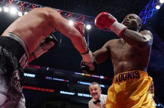 """(FILES) In this file photo taken on December 1, 2018 Oleksandr Gvosdyk (black trunk) punches Adonis Stevenson (gold trunk) during their WBC light heavyweight championship fight at the Videotron Center  in Quebec City, Quebec, Canada. - Canadian boxer Adonis Stevenson remained sedated in hospital but his condition improved to """"stable,"""" his doctors said December 3, 2018 after the fighter lost his World Boxing Council light heavyweight title to Ukrainian Oleksandr Gvozdyk.""""He is still in the intensive care unit and under controlled sedation,"""" the University Hospital of Quebec said in a statement. """"His condition remains stable."""" (Photo by MATHIEU BELANGER / GETTY IMAGES NORTH AMERICA / AFP)"""
