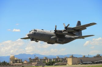 "(FILES): In this July 14, 2015 photograph courtesy of the US Air Force, a C-130 Hercules takes off during a training exercise at Yokota Air Base, Japan. - Two US Marine Corps aircraft crashed during a refueling operation off the coast of Japan, a US defense official told AFP on Wednesday, December 5, 2018. The planes involved were an F-18 fighter and a C-130 tanker, the official said. In a statement, the Marine Corps said the planes had taken off from Marine Corps Air Station Iwakuni in southern Japan. Search and rescue operations were underway following a ""mishap."" (Photo by David OWSIANKA / US AIR FORCE / AFP) / == RESTRICTED TO EDITORIAL USE  / MANDATORY CREDIT:  ""AFP PHOTO /  US AIR FORCE / Senior Airman David OWSIANKA"" / NO MARKETING / NO ADVERTISING CAMPAIGNS /  DISTRIBUTED AS A SERVICE TO CLIENTS  =="