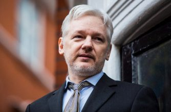 (FILES) In this file photo taken on February 05, 2016 WikiLeaks founder Julian Assange addresses the media from the balcony of the Ecuadorian embassy in central London. - Ecuador's president said on December 6, 2018, that conditions have been met for WikiLeaks founder Julian Assange to leave the country's embassy in London, which would end a six-year standoff with British authorities. Moreno, however, said Britain had guaranteed that the 47-year-old Australian would not be extradited to any country where his life would be in danger. (Photo by Jack Taylor / AFP)