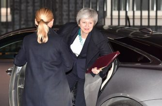 Britain's Prime Minister Theresa May returns to Downing street after postponing a  parliamentary vote on her Brexit deal in London on December 10, 2018. (Photo by Ben STANSALL / AFP)