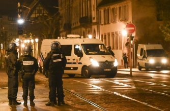 Police stand in the streets of Strasbourg, eastern France, after a shooting breakout, on December 11, 2018. - A gunman killed at least four  people and seriously injured another 11 near the famed Christmas market in the French city of Strasbourg before fleeing the scene, security officials said. Police launched a manhunt after the killer opened fire at around 7pm local time (1800 GMT), sending crowds of evening shoppers fleeing for safety. (Photo by Sébastien BOZON and SEBASTIEN BOZON / AFP)