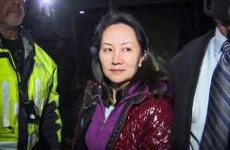 This TV image provided by CTV to AFP shows Huawei Technologies Chief Financial Officer Meng Wanzhou as she exits the court registry following the bail hearing at British Columbia Superior Courts in Vancouver, British Columbia on December 11, 2018. - Meng Wanzhou, the chief financial officer of Huawei, was released on Can$10 million (US$7.5 million) bail on Tuesday in a case that has rattled relations between China, the United States and Canada. (Photo by - / CTV / AFP) / - Canada OUT