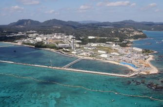 """This aerial view shows land reclamation work on the Henoko coastal district of Nago, Okinawa prefecture, on December 14, 2018, to build a new site for relocating a US military airbase. - Japan resumed work to relocate a controversial US military airbase in Okinawa, prompting protests and """"strong anger"""" from the local governor. (Photo by JIJI PRESS / JIJI PRESS / AFP) / Japan OUT"""