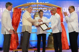 Philippine President Rodrigo Duterte (C) watches as Philippine Defence Secretary Delfin Lorenzana (2nd R) receives a certificate of transfer for three Balangiga church bells from the US embassy in Manila's deputy chief of mission, John Law (2nd L), during a ceremony in Balangiga in Eastern Samar province on December 15, 2018, as US Deputy Assistant Secretary of Defense for South and Southeast Asia Joseph Felter (L) and Philippine Foreign Affairs Spokesman Ernesto Abella (R) look on. - The sleepy central Philippine town of Balangiga erupted in joy on December 15 as bells looted from its church more than a century ago by vengeful US troops were turned over to the community, and rang once again on their home soil. (Photo by TED ALJIBE / AFP)