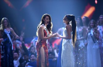 Catriona Gray of the Philippines (L) reacts after winning the Miss Universe 2018 with Miss Universe first runner up Tamaryn Green of South Africa on December 17, 2018 in Bangkok. (Photo by Lillian SUWANRUMPHA / AFP)