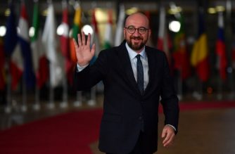 (FILES) In this file photo taken on October 17, 2018, Belgium's Prime Minister Charles Michel waves upon his arrival at the European Council in Brussels. - Belgian Prime Minister Charles Michel announces resignation on the evening of December 18, 2018. (Photo by Ben STANSALL / AFP)