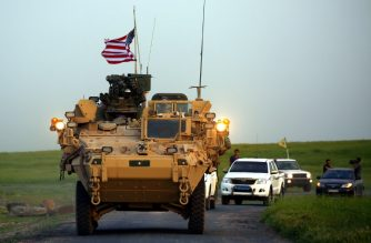 (FILES) In this file photo taken on April 28, 2017 US forces, accompanied by Kurdish People's Protection Units (YPG) fighters, drive their armoured vehicles near the northern Syrian village of Darbasiyah, on the border with Turkey. - The United States is preparing to withdraw its troops from Syria, US media reported on December 19, 2018, a major move that throws into question America's role in the region. (Photo by DELIL SOULEIMAN / AFP)