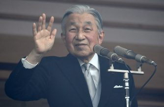 """Japan's Emperor Akihito waves to well-wishers on his birthday at the Imperial Palace on December 23, 2018. - Japan's Emperor Akihito made a rare emotional address ahead of his abdication next year, his voice trembling as he discussed the legacy of the World War II and his appreciation for Empress Michiko and the public. Akihito, who marked his 85th birthday on December 23, said in a pre-recorded press address that he sensed """"deep comfort"""" that his 30-year reign was ending without war in Japan. (Photo by Toshifumi KITAMURA / AFP)"""