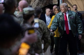 US President Donald Trump and First Lady Melania Trump arrive to speak to members of the US military during an unannounced trip to Al Asad Air Base in Iraq, December 26, 2018. - President Donald Trump arrived in Iraq on his first visit to US troops deployed in a war zone since his election two years ago (Photo by SAUL LOEB / AFP)