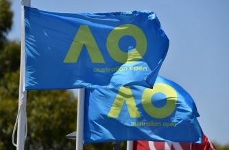 Australian Open flags flutter in the wind on day five of the Australian Open tennis tournament in Melbourne on January 19, 2018. (Photo by Paul Crock / AFP) / -- IMAGE RESTRICTED TO EDITORIAL USE - STRICTLY NO COMMERCIAL USE --