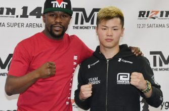 LAS VEGAS, NEVADA - DECEMBER 06: Floyd Mayweather Jr. (L) and Tenshin Nasukawa pose during a news conference at the Mayweather Boxing Club on December 6, 2018 in Las Vegas, Nevada. The two will meet in a three-round boxing exhibition at Saitama Prefecture Super Arena in Saitama, Japan on December 31, 2018.   Ethan Miller/Getty Images/AFP