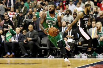 WASHINGTON, DC - DECEMBER 12: Kyrie Irving #11 of the Boston Celtics drives around Markieff Morris #5 of the Washington Wizards in overtime of the Celtics win at Capital One Arena on December 12, 2018 in Washington, DC. NOTE TO USER: User expressly acknowledges and agrees that, by downloading and or using this photograph, User is consenting to the terms and conditions of the Getty Images License Agreement.   Rob Carr/Getty Images/AFP
