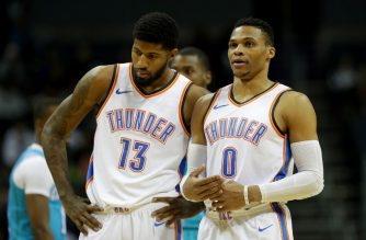 CHARLOTTE, NC - JANUARY 13: Teammates Paul George #13 and Russell Westbrook #0 of the Oklahoma City Thunder talk during their game against the Charlotte Hornets at Spectrum Center on January 13, 2018 in Charlotte, North Carolina. NOTE TO USER: User expressly acknowledges and agrees that, by downloading and or using this photograph, User is consenting to the terms and conditions of the Getty Images License Agreement.   Streeter Lecka/Getty Images/AFP