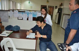 Former Senator Bong Revilla undergoes a medical check-up at the Philippine National Police's Crime Lab on Friday, Dec. 7, after posting a P480,000 bail for the 16 counts of graft filed against him. Earlier in the day, Revilla was acquitted by the Sandiganbayan of plunder./PNP/