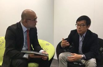 OPEN FOR BUSINESS  anchor Caesar Vallejos interviews  guest Mr. Billy Wong, Deputy Director for Research of the Hong Kong Trade Development Council at the Hong Kong Convention and Exhibition Centre, on Saturday, December 8, 2018)