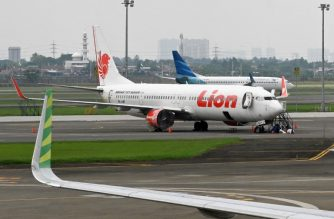 This picture taken on November 27, 2018 shows Lion Air and Garuda Indonesia planes at the Sukarno-Hatta International Airport in Tangerang, on the outskirts of Jakarta. - Indonesia is one of the world's fastest-growing aviation markets, but it has come under fresh scrutiny since a fatal Lion Air crash last month as the sector struggles to keep up with its breakneck expansion, putting safety at risk, analysts warn. (Photo by Adek BERRY / AFP) / TO GO WITH Indonesia-aviation-safety-accident-LionAir, FOCUS by Kiki Siregar