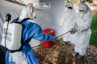 Medical staff of the Ebola Treatment Unit (ETU) get ready to work in their Personal Protective Equipment (PPE) during their weekly rehearsal at the Bwera General Hospital in Bwera bordering with DRC, western Uganda, on December 12, 2018. - The second largest Ebola outbreak in Africa has strated in Democratic Republic of Congo causing 298 deaths since August 2018, according to the World Health Organization (WHO). (Photo by Isaac Kasamani / AFP)