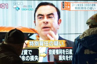"Pedestrians look at a television screen showing a news program featuring former Nissan chief Carlos Ghosn in Tokyo on December 21, 2018. - Japanese prosecutors re-arrested former Nissan boss Carlos Ghosn over fresh allegations on December 21, apparently dashing his hopes of early release in the latest twist to a rollercoaster saga. (Photo by Kazuhiro NOGI / AFP) / ""The erroneous mention[s] appearing in the metadata of this photo has been modified in AFP systems in the following manner: [KAZUHIRO NOGI / AFP] instead of [JIJI PRESS]. Please immediately remove the erroneous mention[s] from all your online services and delete it (them) from your servers. If you have been authorized by AFP to distribute it (them) to third parties, please ensure that the same actions are carried out by them. Failure to promptly comply with these instructions will entail liability on your part for any continued or post notification usage. Therefore we thank you very much for all your attention and prompt action. We are sorry for the inconvenience this notification may cause and remain at your disposal for any further information you may require."""