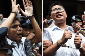 "(FILES) This combo file photo taken on September 03, 2018 shows journalists Kyaw Soe Oo (L) and Wa Lone (R) being escorted by police after their sentencing by a court to jail in Yangon on September 3, 2018. - Lawyers lodged an appeal December 24 to free two Reuters journalists jailed for their reporting on Myanmar's Rohingya crisis, decrying the sentence as a ""mistake"" that has already resulted in the pair being locked up for a year. (Photo by Ye Aung THU / AFP)"