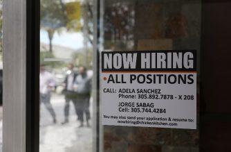 (FILES) In this file photo taken on September 7, 2018  a 'now hiring' sign is seen in a restaurant window in Miami, Florida. - Hiring by private US companies surged unexpectedly in December, rising to its highest level in nearly two years as employers beefed up staffing levels in the holiday period, a survey showed on January 3, 2019. The result shattered economists' forecasts, showing that employers continued to add workers despite fears of a slowing economy, a stock market slump and a trade war with China. (Photo by JOE RAEDLE / GETTY IMAGES NORTH AMERICA / AFP)