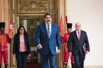"""This handout pictured released by Venezuela's presidential press office shows Venezuelan President Nicolas Maduro walking to a press conference, flanked by Vice-President Delcy Rodriguez (L) and Oil Minister and President of the Venezuelan state oil company PDVSA Manuel Quevedo (R), at the Miraflores Palace on January 7, 2019. (Photo by Francisco BATISTA / Venezuelan Presidency / AFP) / RESTRICTED TO EDITORIAL USE-MANDATORY CREDIT """"AFP PHOTO/VENEZUELAN PRESIDENCY/FRANCISCO BATISTA/HO"""" NO MARKETING NO ADVERTISING CAMPAIGNS-DISTRIBUTED AS A SERVICE TO CLIENTS-GETTY OUT"""