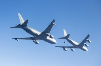 """(FILES) In this October 19, 2015 US Air Force photo, a Boeing KC-46A (L) conducts tests of aircraft acceleration and vibration exposure while flying in receiver formation at various speeds and altitudes over Edwards Air Force Base, California. - The US Air Force on January 10, 2019, took delivery of its first KC-46A Pegasus tanker, though the new type of aerial refueler remains beset with technical problems and is not fully operational. (Photo by Handout / US AIR FORCE / AFP) / RESTRICTED TO EDITORIAL USE - MANDATORY CREDIT """"AFP PHOTO / US AIR FORCE / PO1 CHRISTOPHER OKULA"""" - NO MARKETING NO ADVERTISING CAMPAIGNS - DISTRIBUTED AS A SERVICE TO CLIENTS"""