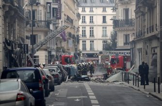 Firefighters intervene after the explosion of a bakery on the corner of the streets Saint-Cecile and Rue de Trevise in central Paris on January 12, 2019. - A large explosion badly damaged a bakery in central Paris on January 12, injuring several people and smashing windows in surrounding buildings, police and AFP journalists at the scene said. A fire broke out after the blast at around 9am (0800 GMT) in the busy 9th district of the city, which police suspect may have been caused by a gas leak. (Photo by Geoffroy VAN DER HASSELT / AFP)