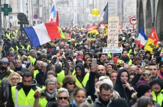 "Protesters gather during a demonstration of the Yellow Vest (Gilets jaunes) movement in La Rochelle, southwestern France, on January 12, 2019. - France braced for a fresh round of ""yellow vest"" protests across the country on January 12, with the authorities vowing zero tolerance for violence after weekly scenes of rioting and vandalism in Paris and other cities over the past two months. (Photo by XAVIER LEOTY / AFP)"