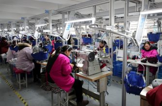 This photo taken on January 12, 2019 shows workers making caps for export in a textile workshop in Lianyungang, in China's eastern Jiangsu province. - China's global trade volume rose last year but its surplus fell again as its imports outpaced its exports, official data released on January 14 showed amid a bruising trade war with the United States. (Photo by STR / AFP) / China OUT