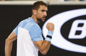 Croatia's Marin Cilic reacts after a point against Australia's Bernard Tomic during their men's singles match on day one of the Australian Open tennis tournament in Melbourne on January 14, 2019. (Photo by DAVID GRAY / AFP) / -- IMAGE RESTRICTED TO EDITORIAL USE - STRICTLY NO COMMERCIAL USE --