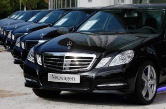"(FILES) In this file photo taken on October 6, 2010 brand new Mercedes cars are on display at the auto company's show rooms in Berlin. - Long envied for its economic strength and insolent surpluses, Germany is anxiously awaiting the first estimate on January 15, 2019 of its 2018 gross domestic product, which could reveal a ""technical recession"" and poison the budget debate. (Photo by David GANNON / AFP)"