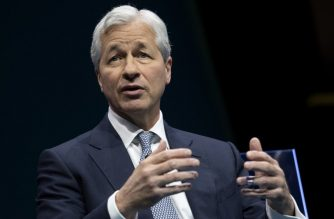 "(FILES) In this file photo taken on December 6, 2018 JPMorgan Chase & Co. CEO Jamie Dimon speaks during the Business Roundtable CEO Innovation Summit in Washington, DC. - Earnings at JPMorgan Chase jumped in the fourth quarter, but not as much as expected due to weak trading activity and increased technology spending, according to results released January 15, 2019.Net income surged 67 percent to $7.1 billion, with the year-ago period hit by one-time accounting costs from US tax reform. Revenues rose four percent to $26.8 billion. Chief Executive Jamie Dimon termed 2018 ""another strong year"" and called on political leaders to work together, implicitly acknowledging a government shutdown now in its fourth week amid fighting in Washington. (Photo by Jim WATSON / AFP)"