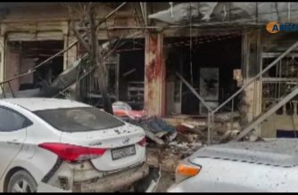 An image grab taken from a video published by Hawar News Agency (ANHA) on January 16, 2019, shows the aftermath of a suicide attack in the northern Syrian town of Manbij. - A suicide attack targeting US-led coalition forces in the flashpoint northern Syrian city of Manbij killed a US serviceman and 14 other people today, a monitor said. (Photo by - / various sources / AFP)