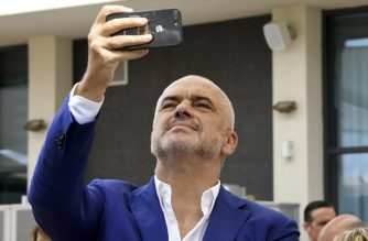 This photo taken on August 27, 2018, shows Albanian Prime Minister Edi Rama taking pictures in Tirana. - When it comes to quelling protests or skewering the opposition, Albania's spunky Prime Minister Edi Rama is embracing the art of the internet meme, deploying quirky web humour and pop references as he wages his political battles online. (Photo by GENT SHKULLAKU / AFP)