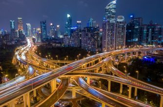 (FILE) This aerial file picture taken on November 12, 2018 shows traffic on an elevated intersection in downtown Shanghai. - China's economic growth ground to its slowed pace in almost three decades in 2018, analysts said in an AFP survey released January 2019, as the government battled ballooning debt and a bruising US trade war. (Photo by JOHANNES EISELE / AFP)