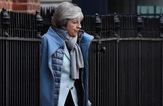 "Britain's Prime Minister Theresa May leaves from the rear of 10 Downing Street in central London on January 18, 2019. - British Prime Minister Theresa May scrambled to put together a new Brexit strategy after MPs rejected her EU divorce deal, and insisted she could not rule out a potentially damaging ""no-deal"" split. (Photo by Ben STANSALL / AFP)"