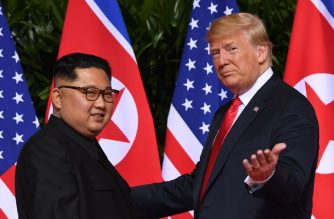 "(FILES) In this file photo taken on June 12, 2018 US President Donald Trump (R) meets with North Korea's leader Kim Jong Un (L) at the start of their US-North Korea summit, at the Capella Hotel on Sentosa Island in Singapore. - Trump and Kim will hold a summit ""near the end of February,"" the White House said on january 18, 2019, without specifying the location. ""The president looks forward to meeting with Chairman Kim at a place to be announced at a later date,"" spokeswoman Sarah Sanders said after Trump met for 90 minutes with top North Korean general Kim Yong Chol. (Photo by SAUL LOEB / AFP)"