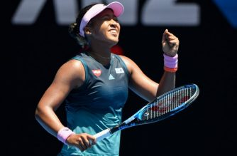 Japan's Naomi Osaka celebrates her victory against Latvia's Anastasija Sevastova during their women's singles match on day eight of the Australian Open tennis tournament in Melbourne on January 21, 2019. (Photo by Peter PARKS / AFP) / -- IMAGE RESTRICTED TO EDITORIAL USE - STRICTLY NO COMMERCIAL USE --