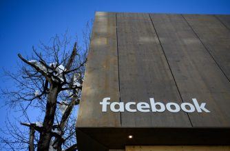A picture taken on January 24, 2019 shows the Facebook booth during the World Economic Forum (WEF) annual meeting in Davos, eastern Switzerland. (Photo by Fabrice COFFRINI / AFP)