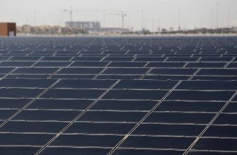 TO GO WITH AFP STORY BY WISSAM KEYROUZ A general view taken on October 7, 2015 shows a 10-megawatt solar farm on the outskirts of Masdar City outside the rich Emirate of Abu Dhabi. Masdar City -- which hosts the International Renewable Energy Association Agency (IRENA) and the Masdar Institute for Science and Technology -- is at the forefront of the UAE's efforts to focus on renewables. AFP PHOTO / KARIM SAHIB (Photo by KARIM SAHIB / AFP)