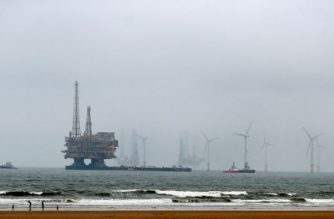 (File photo) Shell's Brent Delta Topside offshore oil drilling rig platform is towed by tug boats along the coastline of Hartlepool to Able Seaton Port for decommissioning, in England on May 2, 2017. (Photo by SCOTT HEPPELL / AFP)