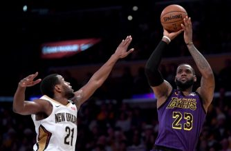 LOS ANGELES, CALIFORNIA - DECEMBER 21: LeBron James #23 of the Los Angeles Lakers scores on a fade away jumper over Darius Miller #21 of the New Orleans Pelicans during a 112-104 Laker win at Staples Center on December 21, 2018 in Los Angeles, California. NOTE TO USER: User expressly acknowledges and agrees that, by downloading and or using this photograph, User is consenting to the terms and conditions of the Getty Images License Agreement.   Harry How/Getty Images/AFP