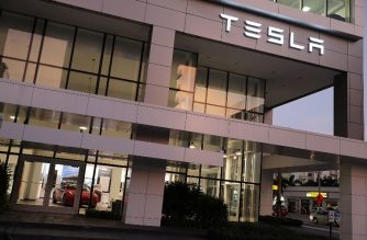 MIAMI, FLORIDA - JANUARY 03: A Tesla vehicle is seen in a dealership on January 03, 2019 in Miami, Florida. Tesla Inc. shares have fallen as the company reported fourth-quarter Model 3 deliveries just below estimates and said it would lower the price of its cars.   Joe Raedle/Getty Images/AFP