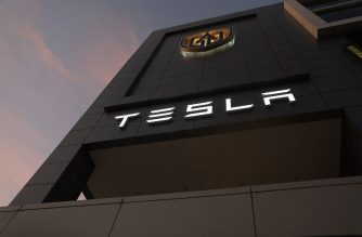 MIAMI, FLORIDA - JANUARY 03: The Tesla name is seen on the exterior of a dealership on January 03, 2019 in Miami, Florida. Tesla Inc. shares have fallen as the company reported fourth-quarter Model 3 deliveries just below estimates and said it would lower the price of its cars.   Joe Raedle/Getty Images/AFP